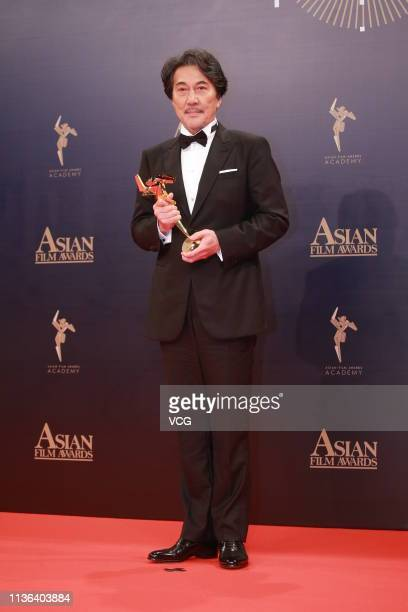 Japanese actor Koji Yakusho poses backstage during the 13th Asian Film Awards on March 17 2019 in Hong Kong China