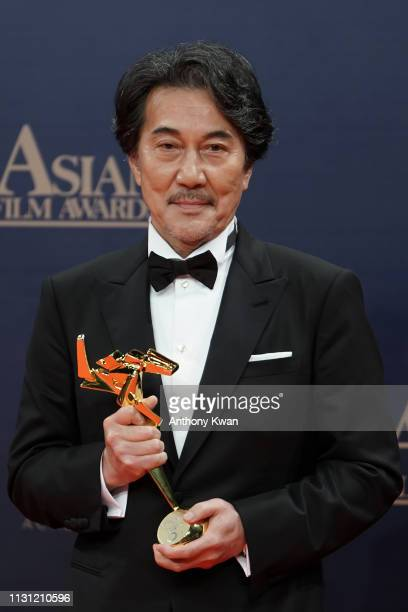 Japanese actor Koji Yakusho poses for a photograph after winning the Excellence at the 13th Asian Film Awards on March 17 2019 in Hong Kong Hong Kong