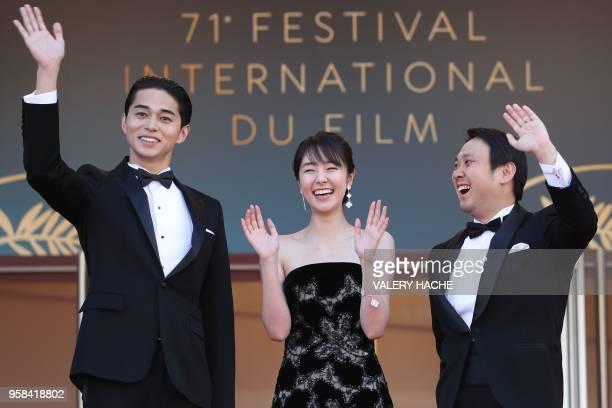 Japanese actor Masahiro Higashide Japanese actress Erika Karata and Japanese director Ryusuke Hamaguchi pose as they arrive on May 14 2018 for the...