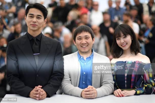 Japanese actor Masahiro Higashide Japanese director Ryusuke Hamaguchi and Japanese actress Erika Karata pose on May 15 2018 during a photocall for...