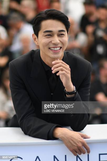 Japanese actor Masahiro Higashide poses on May 15 2018 during a photocall for the film Asako I II at the 71st edition of the Cannes Film Festival in...