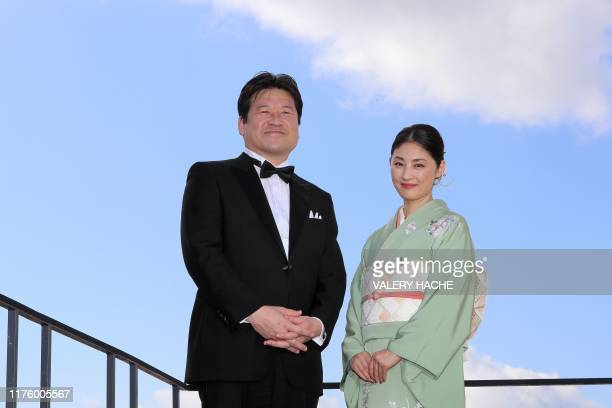 "Japanese actor, screenwriter and film director Jiro Sato and Japanese actress Takako Tokiwa pose during a photocall for the television series ""The..."