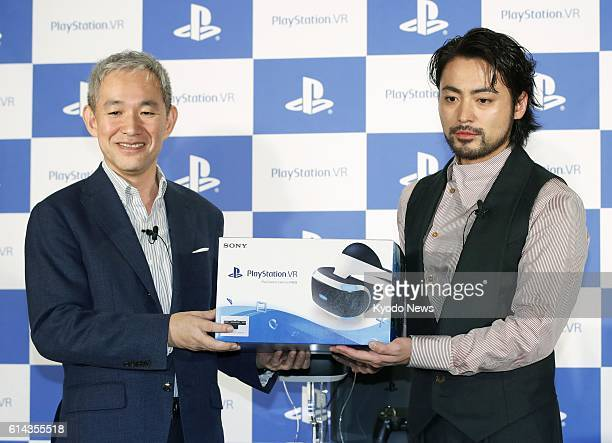 Japanese actor Takayuki Yamada and Atsushi Morita president of Sony Interactive Entertainment Japan Asia pose for photos in Tokyo's Ginza shopping...