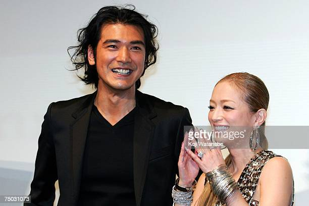 Japanese actor Takeshi Kaneshiro and Singer Ayumi Hamasaki attend the premiere for the new movie 'Confession of Pain' at the TOHO Cinemas on July 4...