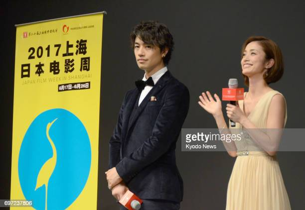 Japanese actor Takumi Saito and actress Aya Ueto attend a screening party at the Shanghai International Film and TV Festival on June 17 2017 The...