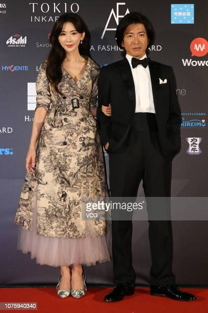 Japanese actor Takuya Kimura and Chinese actress Lin Chiling pose backstage during the Asia Fashion Award 2018 at Chiang Kaishek Memorial Hall on...