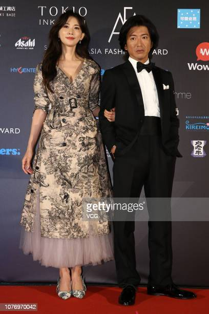 Japanese actor Takuya Kimura and Chinese actress Lin Chiling pose backstage during the Asia Fashion Award 2018 at Chiang Kaisheak Memorial Hall on...