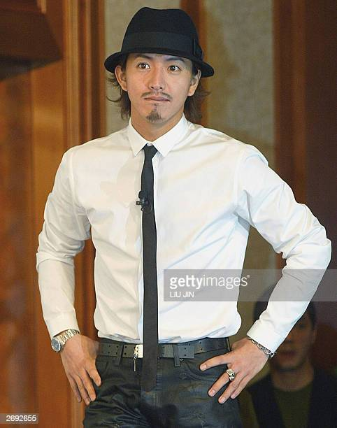 Japanese actor Takuya Kimura arrives at a press conference in Shanghai 03 November 2003 Kimura is in Shanghai to help promote the new film '2046'...