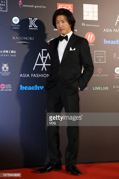 Japanese actor Takuya Kimura poses backstage during the Asia Fashion Award 2018 at Chiang Kaisheak Memorial Hall on December 1 2018 in Taipei Taiwan...