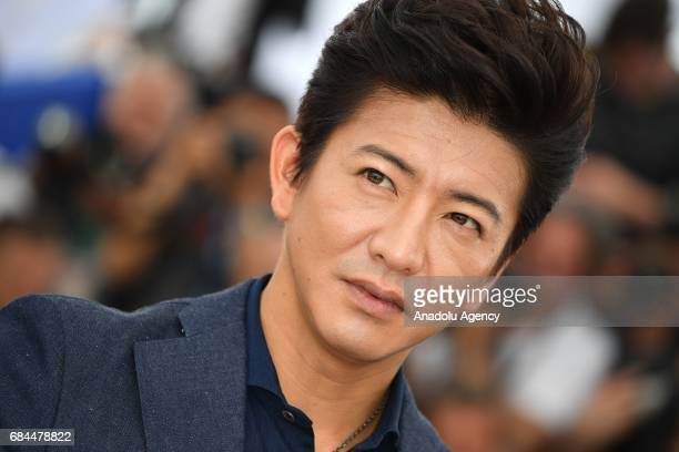 Japanese actor Takuya Kimura poses during a photocall for the film Mugen No Junin' out of competition at the 70th annual Cannes Film Festival in...