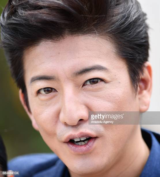 Japanese actor Takuya Kimura poses during a photocall of the Mugen No Junin' out of competition at the 70th annual Cannes Film Festival in Cannes...