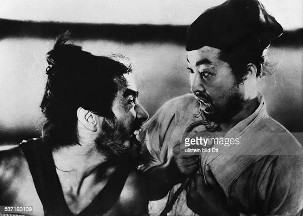 Japanese actor Toshiro Mifune as bandit Tajomaru in the film Rashomon by Japanese director Akira Kurosawa with Takashi Shimura as policeman Japan 1950