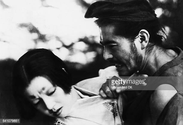 Japanese actor Toshiro Mifune in the film Rashomon by Japanese director Akira Kurosawa with actress Machiko Kyo Japan 1950