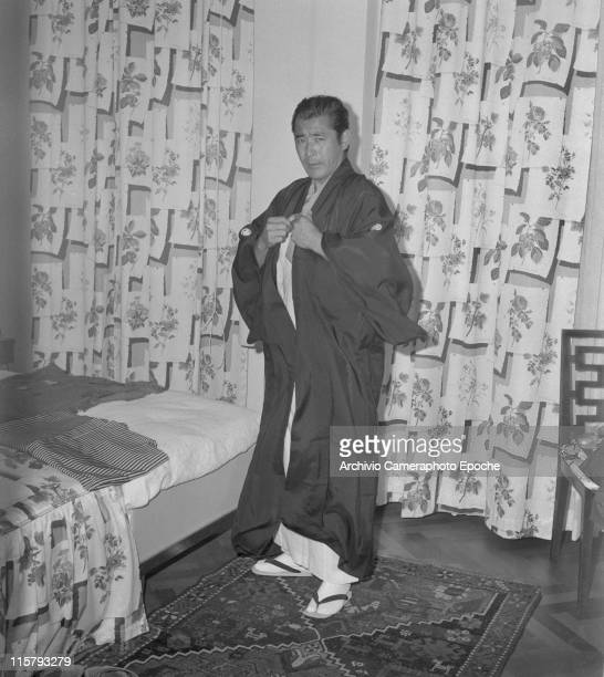 Japanese actor Toshiro Mifune wearing the upper part of the kimono the haori in his hotel room during the Movie Festival Biennale September 1961