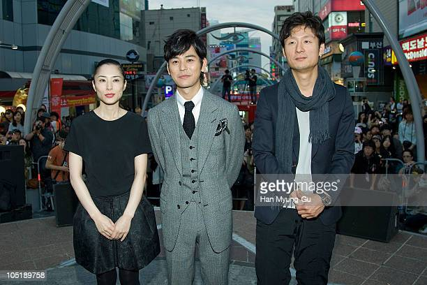 Japanese actors Satoshi Tsumabuki and Fukatsu Eri and director Lee SangIl attend a audience meet and greet at the NampoDong Outdoor Stage during the...