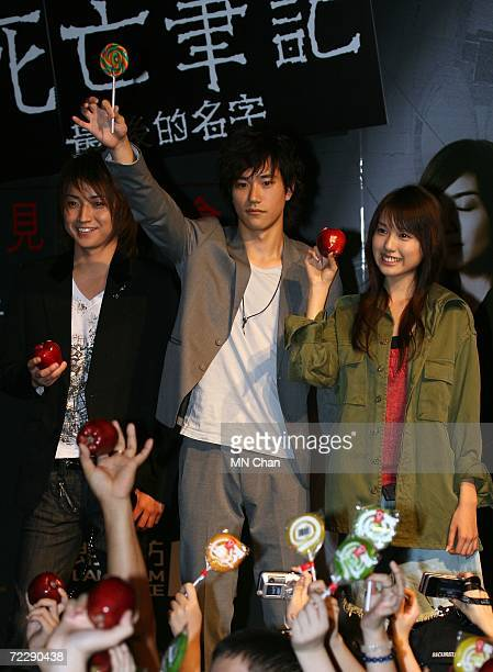 """Japanese actors Tatsuya Fujiwara, Kenichi Matsuyama and Erika Toda greet their fans during a promotion of their new movie """" Death Note: The Last Name..."""