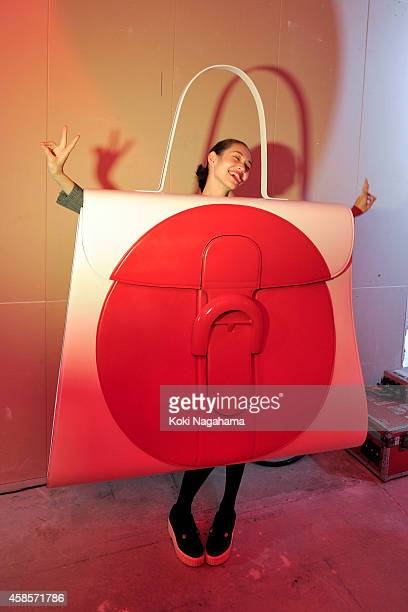 Japanese actress and model Kiko Mizuhara at the Delvaux Red Moon Party at Delvaux Omotesando on November 7 2014 in Tokyo Japan