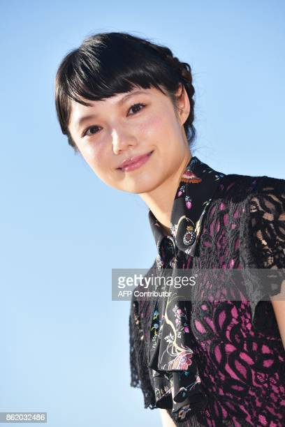 Japanese actress Aoi Miyazaki poses during the MIPCOM trade show in Cannes southern France on October 16 2017 / AFP PHOTO / YANN COATSALIOU