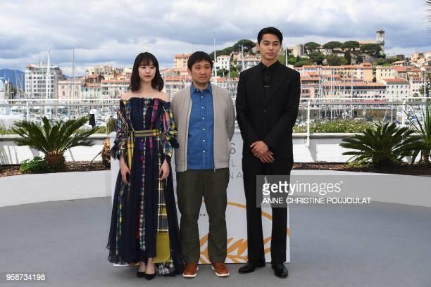 Japanese actress Erika Karata Japanese director Ryusuke Hamaguchi and Japanese actor Masahiro Higashide pose on May 15 2018 during a photocall for...