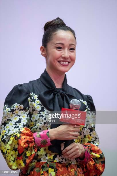 Japanese actress Erika Sawajiri attends a meeting of film 'The Cat In Their Arms' during the 21st Shanghai International Film Festival at Shanghai...
