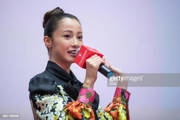 Japanese actress Erika Sawajiri and Japanese director Isshin Inudou attend a meeting of film 'The Cat In Their Arms' during the 21st Shanghai...