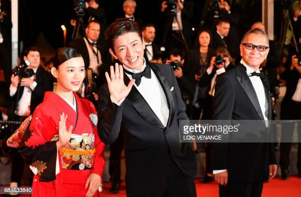 Japanese actress Hana Sugisaki Japanese actor Takuya Kimura and Japanese director Takashi Miike pose as they arrive on May 18 2017 for the screening...