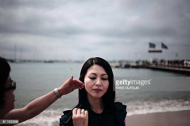 Japanese actress Haruka Igawa gets ready to pose for a photocall for director Kiyoshi Korosawa's film 'Tokyo Sonat' at the 61st Cannes International...