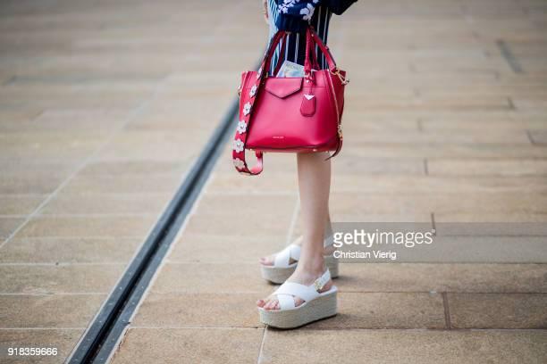 Japanese actress Hikari Mori seen wearing red bag outside Michael Kors on February 14 2018 in New York City
