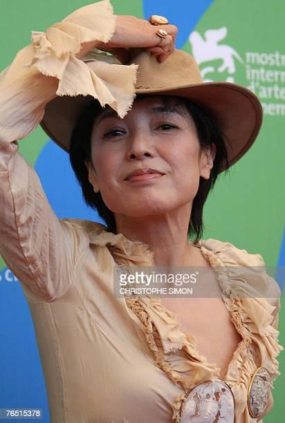 Japanese actress Kaori Momoi poses during a photocall of Sukiyaki Western Django during the 64th Venice International Film Festival at Venice Lido 05...