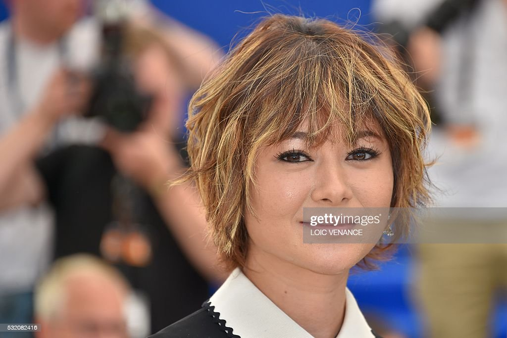 Japanese actress Maki Yoko poses on May 18, 2016 during a photocall for the film 'After the Storm (Umi Yorimo Mada Fukaku)' at the 69th Cannes Film Festival in Cannes, southern France. / AFP / LOIC