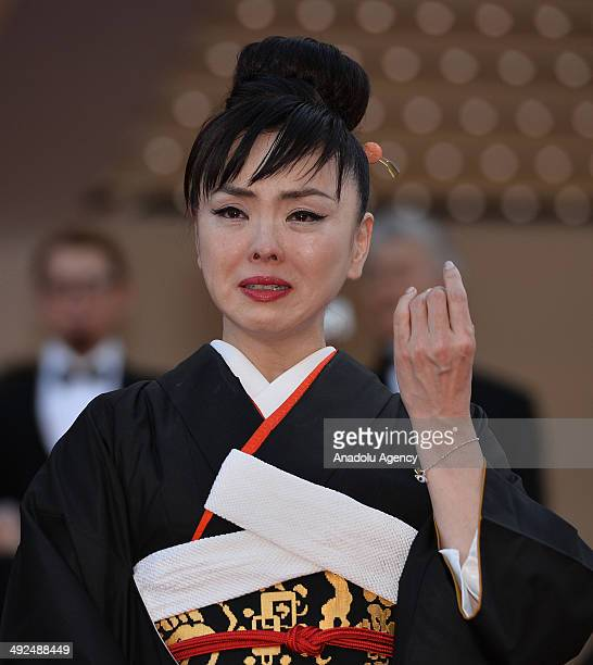 Japanese actress Makiko Watanabe cries as she leave the Festival palace after the screening of the film 'Futatsume No Mado' during the 67th Cannes...