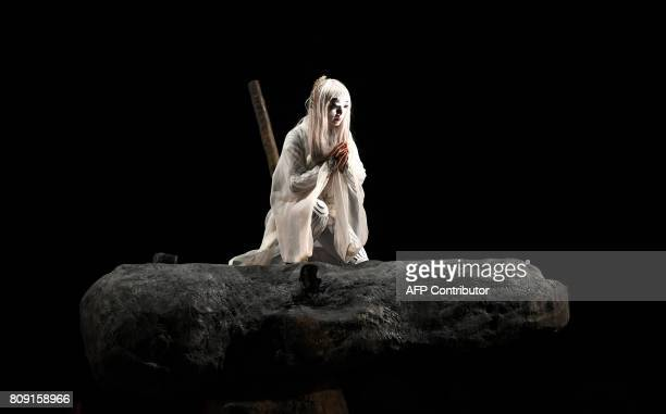 Japanese actress Micari performs as 'Antigone' during a rehearsal of the eponym play by Sophocle directed by Japanese director Satoshi Miyagi on July...