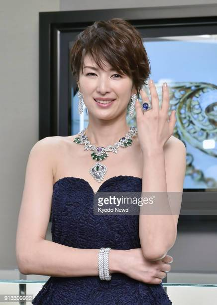 Japanese actress Michiko Kichise shows off jewelry from Van Cleef amp Arpels in Osaka western Japan on Feb 1 during a press preview of the French...