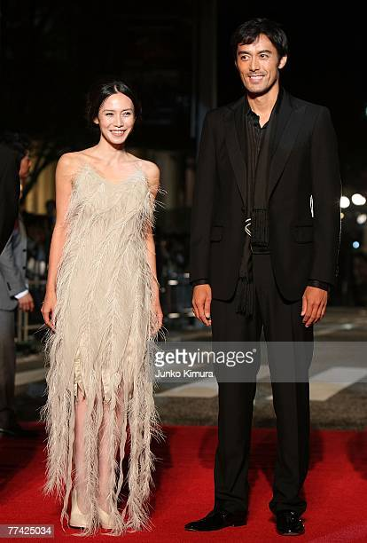 Japanese actress Miki Nakatani and Japanese actor Hiroshi Abe walk on the red carpet during day one of the 20th Tokyo International Film Festival at...