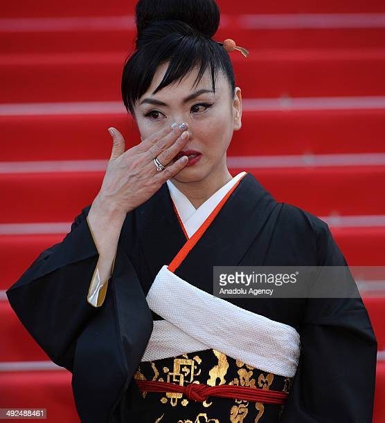 Japanese actress Miyuki Matsuda cries as she leave the Festival palace after the screening of the film 'Futatsume No Mado' during the 67th Cannes...