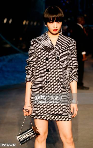 Japanese actress Nana Komatsu poses during a photocall before the Chanel Croisiere fashion show on May 3, 2018 at the Grand Palais in Paris.