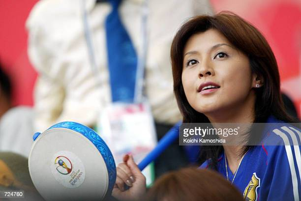 Japanese actress Norika Fujiwara cheers during a 2002 Federation Internationale de Football Association World Cup match between Japan and Tunisia at...