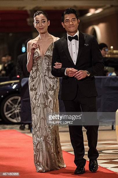 Japanese actress Rie Miyazawa and Hong Kong actor Aaron Kwok are seen on the red carpet during the 9th Asian Film Awards in Macau on March 25 2015...