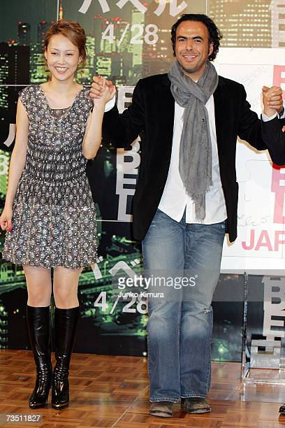 Japanese actress Rinko Kikuchi and director Alejandro Gonzalez Inarritu attend a press conference promoting 'Babel' on March 7 2007 in Tokyo Japan...