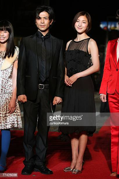 Japanese actress Ryoko Hirosue and actor Shinji Takeda walk on the red carpet during day one of the 20th Tokyo International Film Festival at...