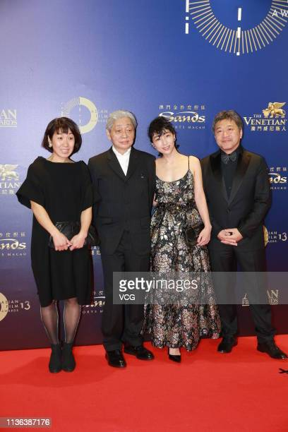 Japanese actress Sakura Ando and Japanese film director Hirokazu Koreeda pose on the red carpet of the 13th Asian Film Awards on March 17 2019 in...