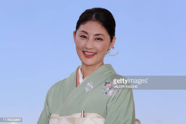"""Japanese actress Takako Tokiwa poses during a photocall for the television series """"The Return"""" as part of the MIPCOM, the World's biggest television..."""