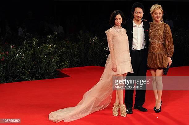 Japanese actresses Kiko Mizuhara Japanese actor Kenichi Matsuyama and actress Rinko Kikuchi arrive for the screening of Norumei no mori at the 67th...