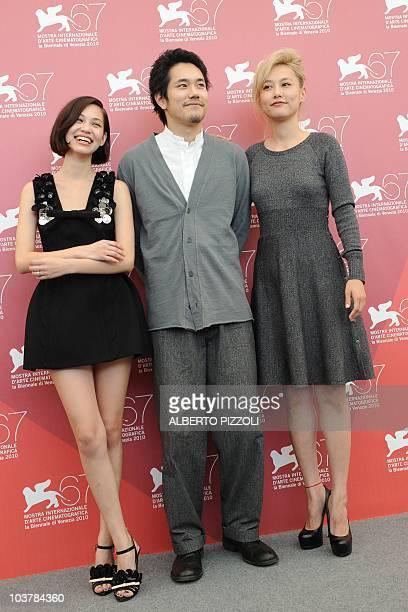 Japanese actresses Kiko Mizuhara Rinko Kikuchi and Japanese actor Kenichi Matsuyama pose during the photocall of Norumei no mori at the 67th Venice...