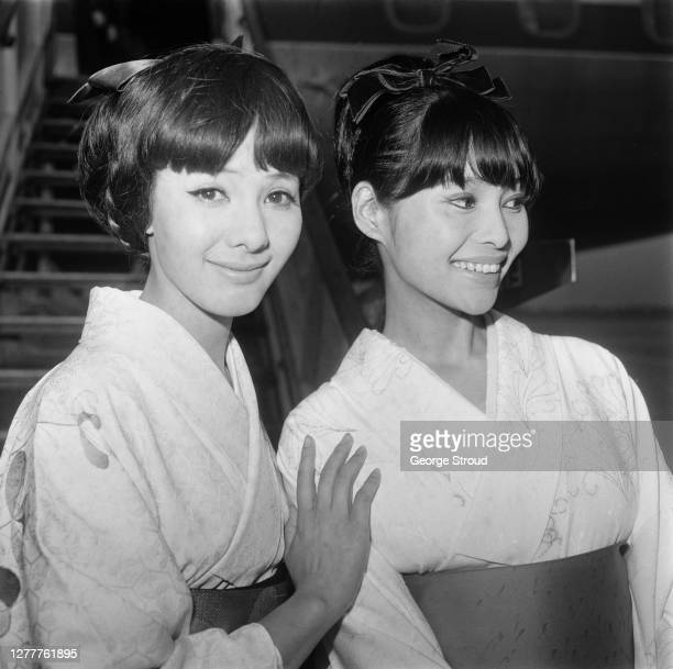 Japanese actresses Mie Hama and Akiko Wakabayashi arrive at London Airport to star in the James Bond film 'You Only Live Twice', UK, 16th June 1966.