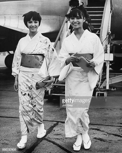 Japanese actresses Mie Hama and Akiko Wakabayashi wearing kimono as they arrive in the UK to star in the James Bond film 'You Only Live Twice' London...