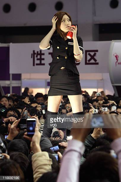Japanese adult video actress Ai Haneda performs on the stage during the 8th China AdultCare Expo at Shanghai International Exhibition Center on March...