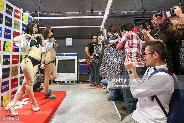 Japanese adult video actresses pose for visitors during the Japan Adult Expo at the Toyosu PIT on November 17 2015 in Tokyo Japan At the Japan Adult...