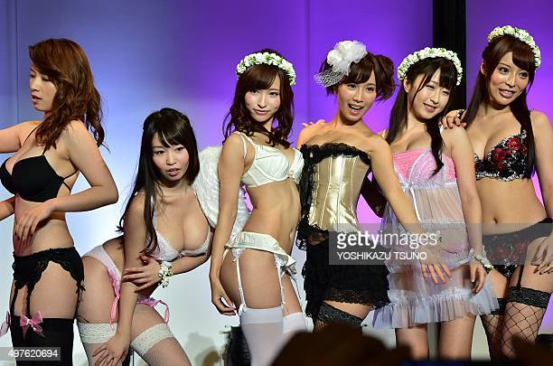 Japanese adult video actresses Saki Okuda Aika Yumeno Moe Tenshi Minami Kojima Arisa Misato and Aya Sakurai pose during a lingerie fashion show at...