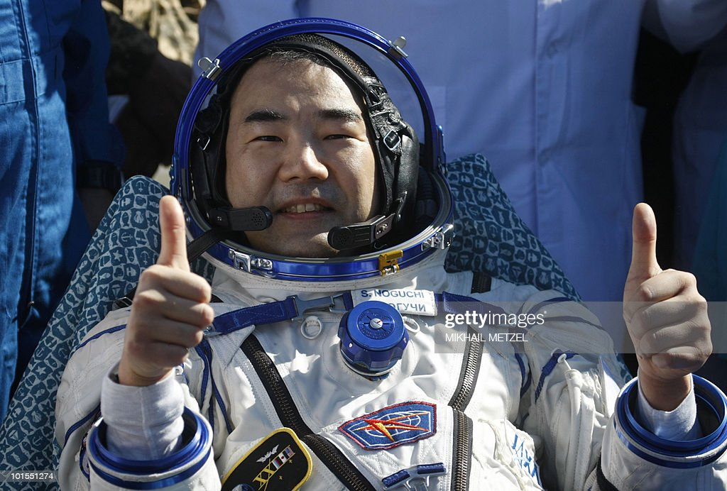 Japanese Aerospace Exploration Agency astronaut Soichi Noguchi gives a thumbs up shortly after the landing of the Russian Soyuz TMA-17 space capsule about 150 km (80 miles) south-east of the Kazakh town of Dzhezkazgan on June 2, 2010. The Soyuz capsule, which carried the three astronauts safely returned to Earth after a half-year stint on the international space station, with a landing in the Kazakh steppe.